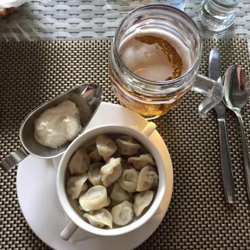 Pelmeni dumplings & fresh lager: a winning Kazakh combo.